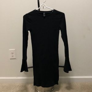 Black dress fitted with bell sleeve